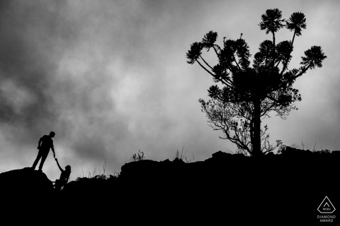 Silhouette portrait of the soon to be bride and groom in the mountain canyons of cambará do sul - RS
