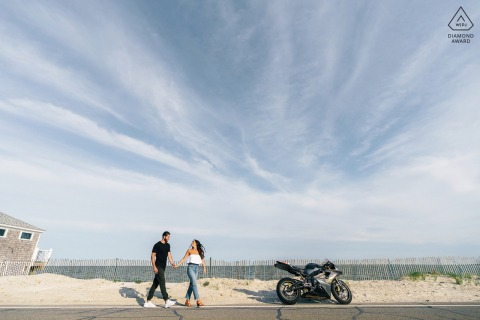 Falmouth Beach couple portrait showing that The ride is about to begin with his race motorcycle