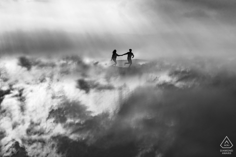Pre-Wedding couple portrait of them running in the clouds over Dalat