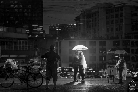 Da Lat city, Vietnam night couple portrait with an umbrella and a light