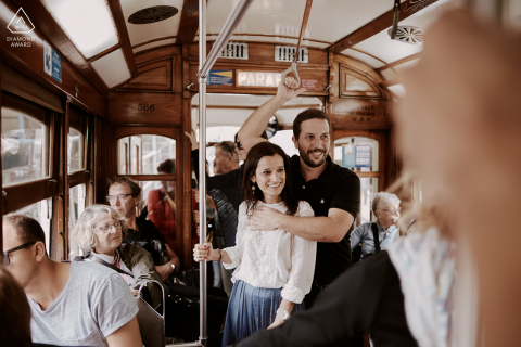engagement Photograph taken inside the tram in Lisbon, portraying the couple's daily life in a genuine way