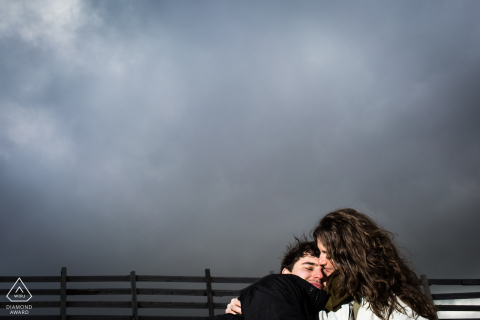 A cloudy snow mountain couple portrait session in Puerto de Navacerrada, Madrid Spain