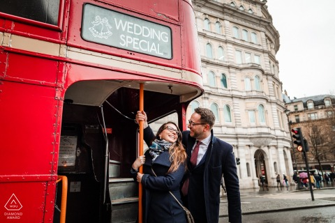 London, UK engagement portrait session with a Little gift by the red bus driver - a Wedding Special, sign