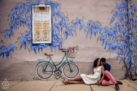 Annapolis Maryland engaged couple sitting for a portrait Under the Wisteria Wall