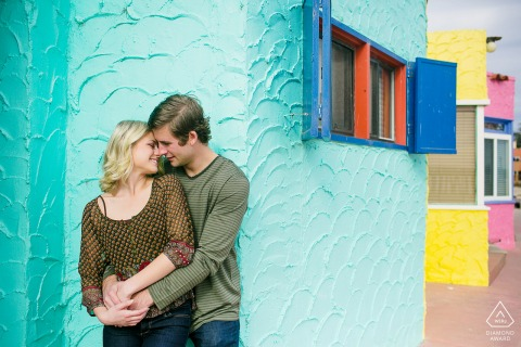 Urban Love with a colorful, stucco background at Capitola Beach, California