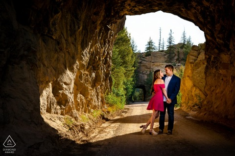 a couple embrace at Eleven Mile Canyon in Lake George, CO during their engagement photography shoot