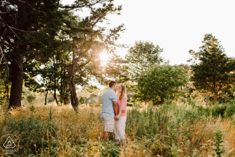 Odiorne State Park of Rye, NH couple engagement photo session in a Dreamy field