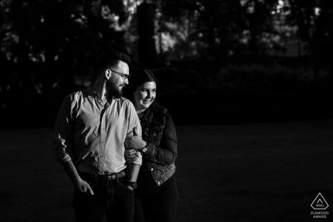 Alberta couple in a stream of evening light at the legislature grounds, Edmonton