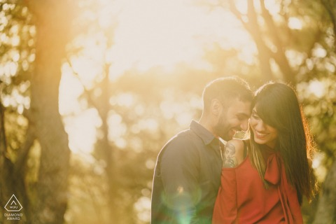 Barcelona couple kissing in sunset light for afternoon engagement portraits