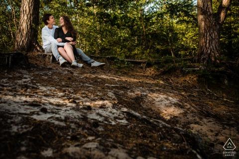 Landgoed Den Treek - Utrecht pre-wedding portrait with a Couple sitting on top of hill