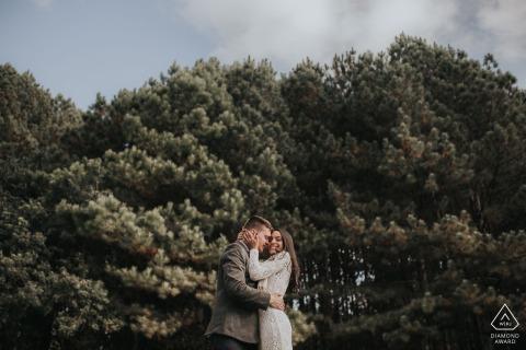 Gramado and Rio Grade do Sul pre-wedding portraits under tall bushes and big clouds