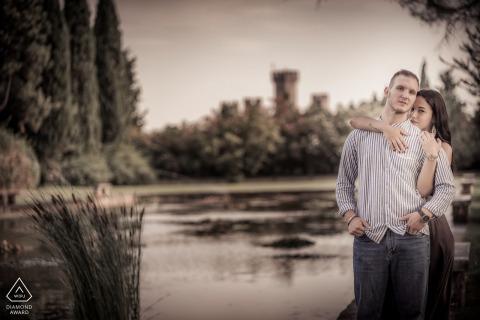 Intense portrait of the couple by the water at Giardini Sigurtà, Valeggio sul Mincio, Italy