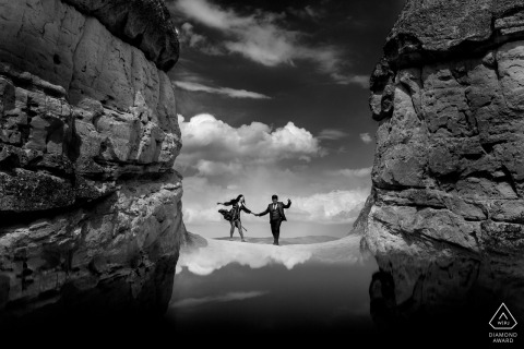 engagement portraits above the clouds and rocks at cappadocia, turkey