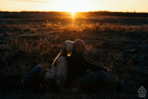 Elk Island, AB, Canada Sunrise portraits in the open field with the couple in love