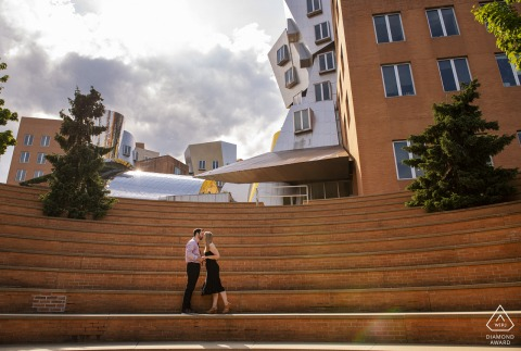 Kissing on huge staircase for prewed portrait at MIT, Cambridge, Massachusetts