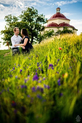 Rosice engagement image of couple standing by the chapel on the hill