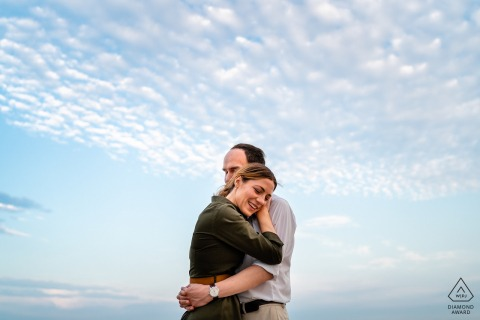 a Trieste, Italy Hug in the sky during engagement portrait session outdoors