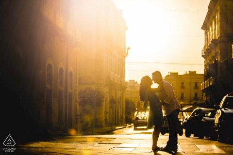 Warm sunlight engagement portrait on the streets of Siracusa