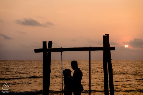 Phu Quoc Island engagement shoot of couple silhouetted against a sunset and water
