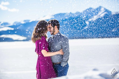 A winter engagement session turned into a snowglobe when a breeze kicked up a flurry of snow at Lake Dillon, Dillon, Colorado