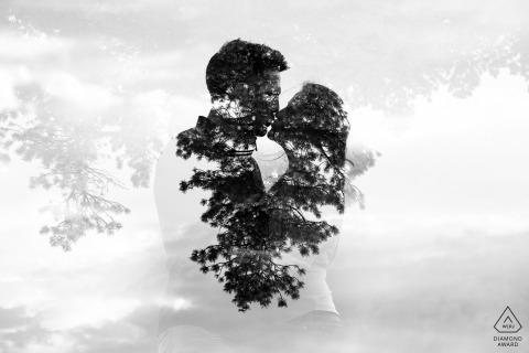 A creative black and white double exposure of the couple in their woodsy engagement session at Mt. Falcon, Denver, Colorado
