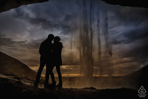 Engagement shoot in Iceland - seljalandsfoss with a silhouette behind a waterfall