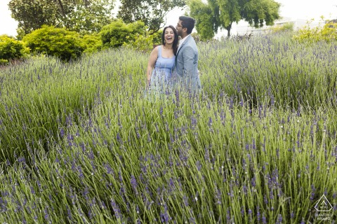 San Francisco lavender laughing couple posing for engagement portraits in the soft light