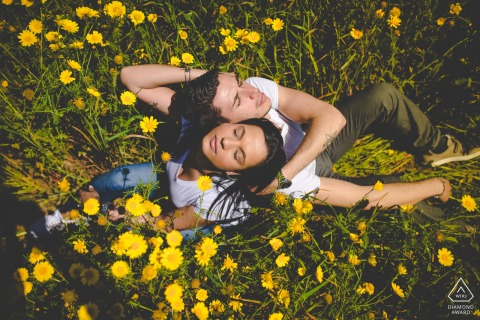 Siracusa flower power love in sicily in this overhead portrait of a couple in a field of flowers