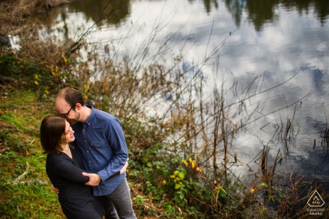 portrait of The sweet couple by the clouds in the lake during engagement shoot in Redwood City