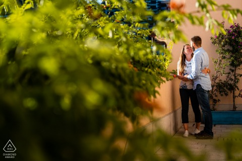 Portopiccolo, Trieste, Italy couple sharing Hugs and green during engagement shoot