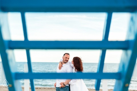 Grado, Italy couple showing off their Love by the sea during portrait session at the water