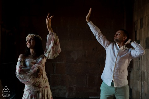 An Ani ruins, Turkey Couple showing their first-dance moves during engagement photoshoot
