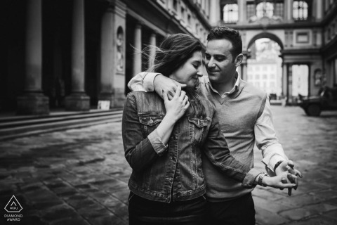 Walking and hugging couple engagement photography at the Uffizi Gallery in Florence