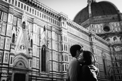 Black and white engagement shoot session in Piazza Duomo, Florence of couple hugging