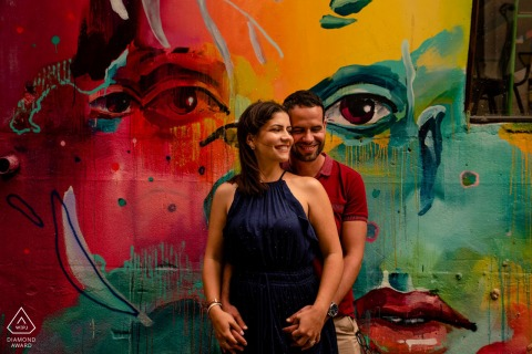 Building graffiti couple engagement image from Lisbon - LX factory against a graffiti wall