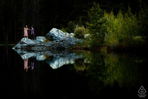 Mountain lake engagement image of the couple reflected in the lake in Frisco, CO