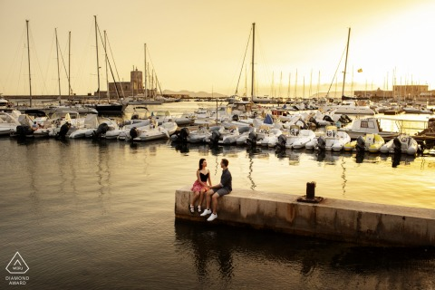 Boat marina sunset couple engagement portraits at the docks in Trapani, Italy