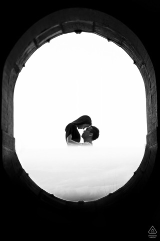 Reflected black and white engagement picture session in Peking University, Beijing, China of the couple's reflection in the doorway