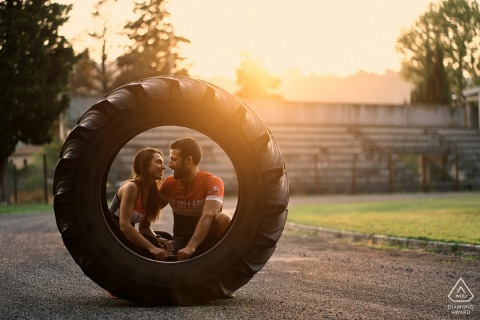Tractor tire cross fit training couple engagement photography in Umbria