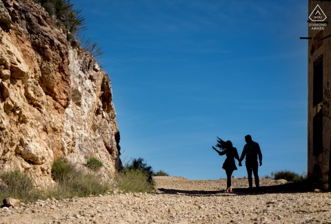 Hair flipping couple engagement photography in Almería - Spain shot as a silhouette in the shadows