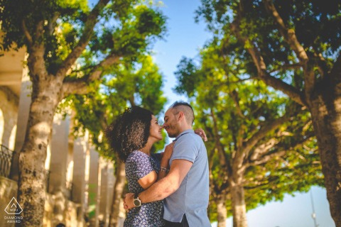 Hugging under the trees couple engagement picture session in Siracusa