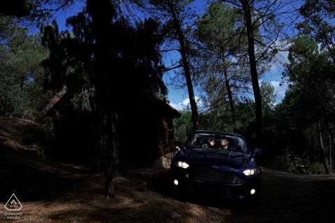 Lit car with headlights on couple engagement photos at Arroyo Frío, Jaén