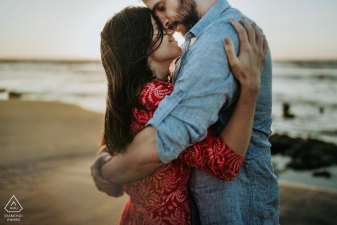Beach hugging couple engagement image from Veules les roses France