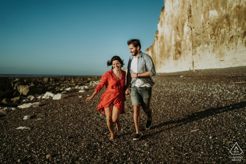 Beach running couple engagement photos at Veules les roses France
