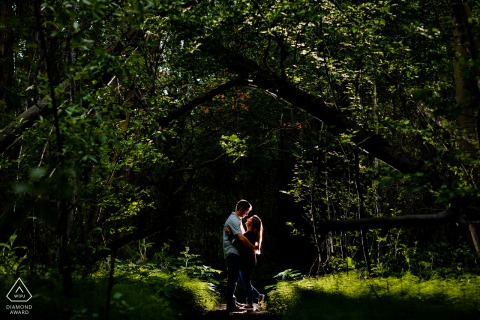 Colorado couple engagement photography at Twin Lakes, CO backlit in the forest