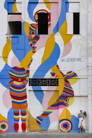 Painted building art couple engagement image from Porto Maravilha, Rio de Janeiro, Brazil