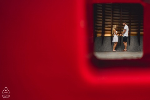 UK urban streets engagement photos in London of couple framed by red