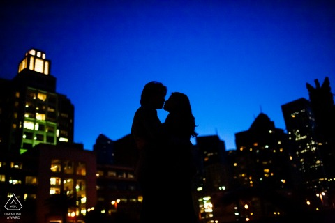 Dusk skyline engagement image from San Francisco of a silhouetted couple at the blue  hour