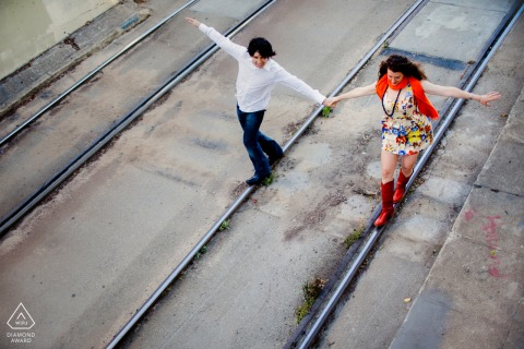 Cable car, rail tracks engagement portraits in San Francisco of couple on a deserted railroad