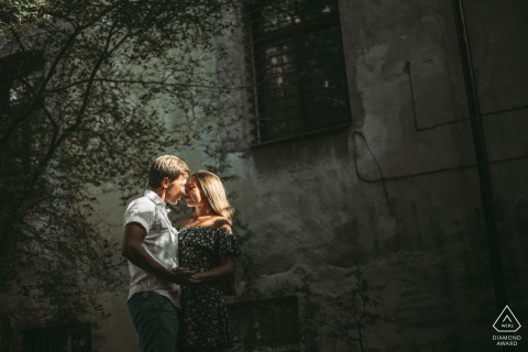 Urban light engagement image from Odessa, Ukraine of a couple posing on a street under harsh light